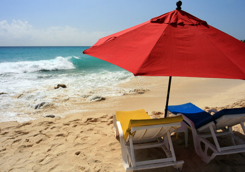 Beach Umbrella, St. Maarten. A couple of chairs and a big umbrella just for you, Maho Bay, St. Maarten stock photography